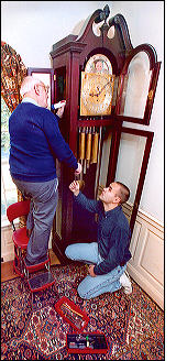 Pat and Chris working on grandfather clock